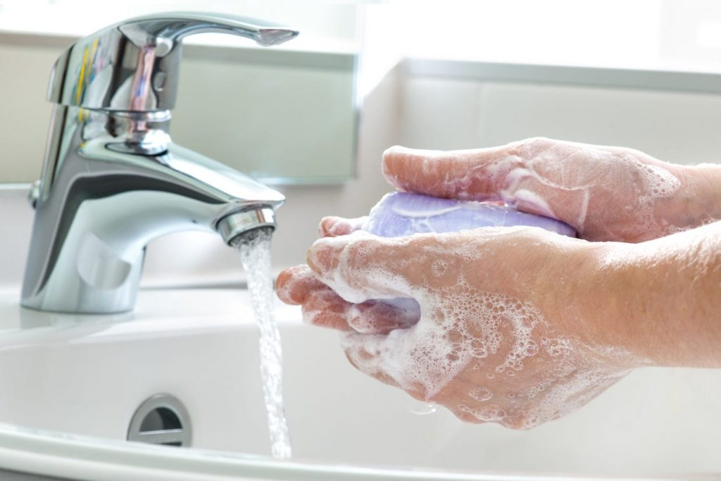 Wash your hands with soap and water: